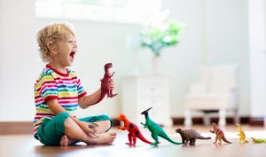 a child playing with dinosaurs