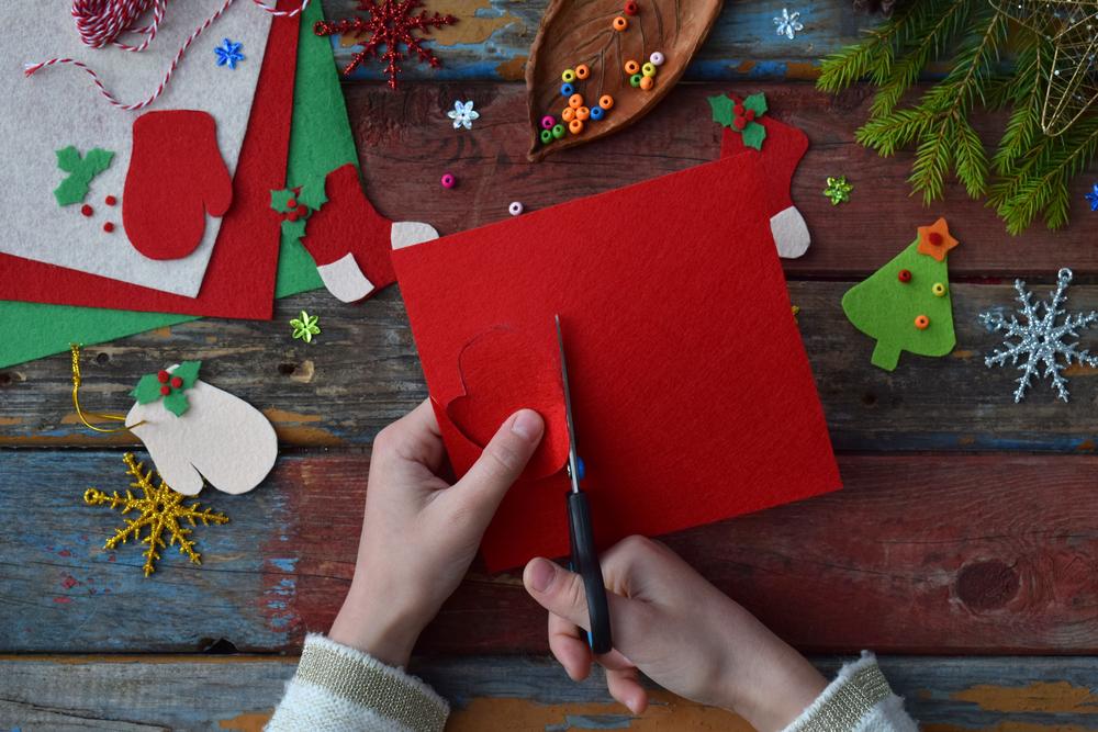 child cutting red paper