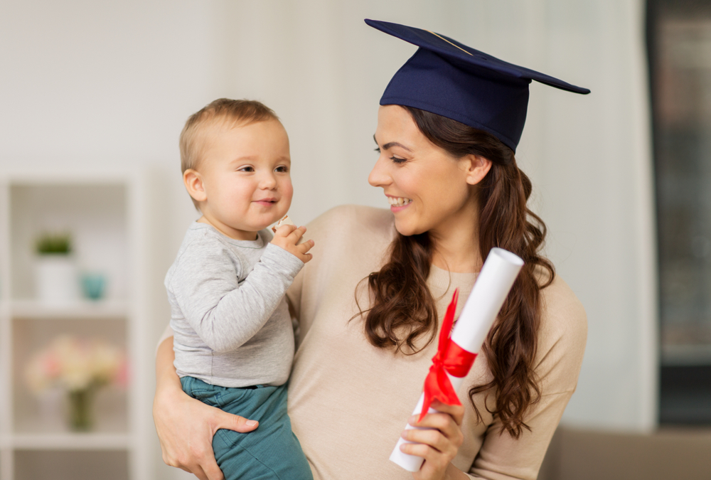 young mom graduate with baby