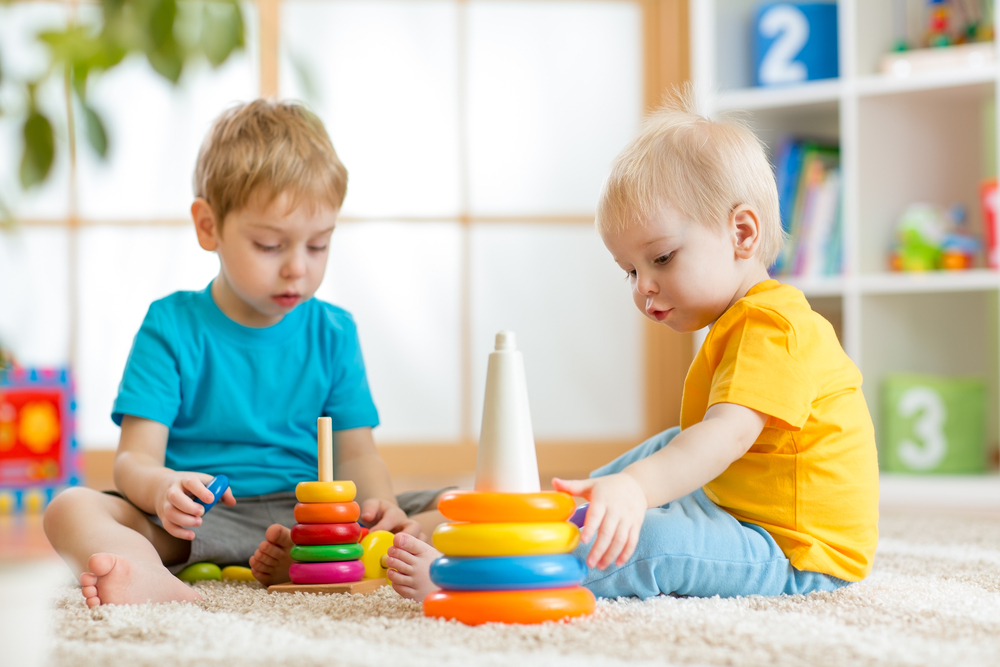 two toddlers playing