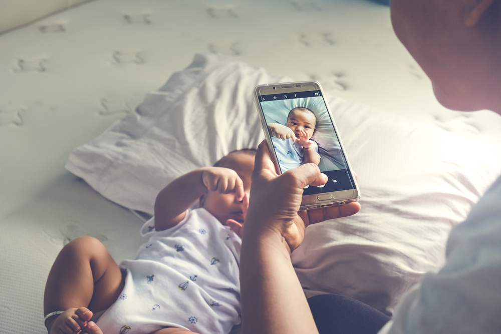 taking a picture of a baby