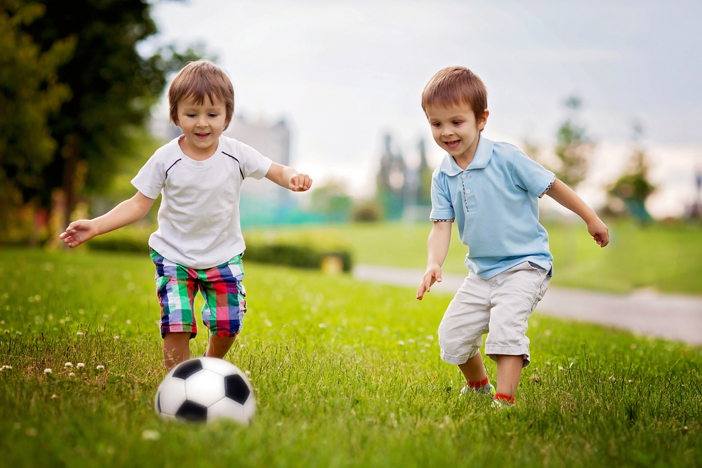 two little boys playing soccer