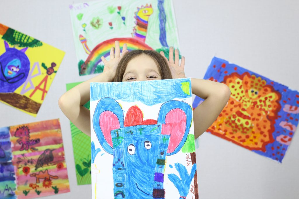 child with paintings